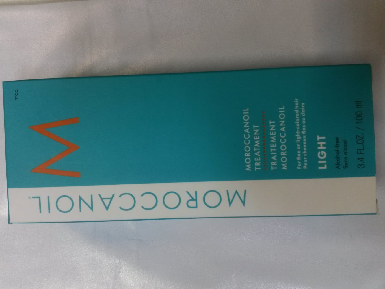 Масло для волос Moroccanoil и Moroccanoil Light